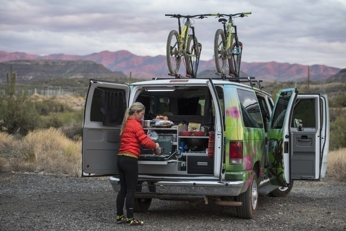 Campervan-kitchen-fitout-bikes-cooking-breakfast