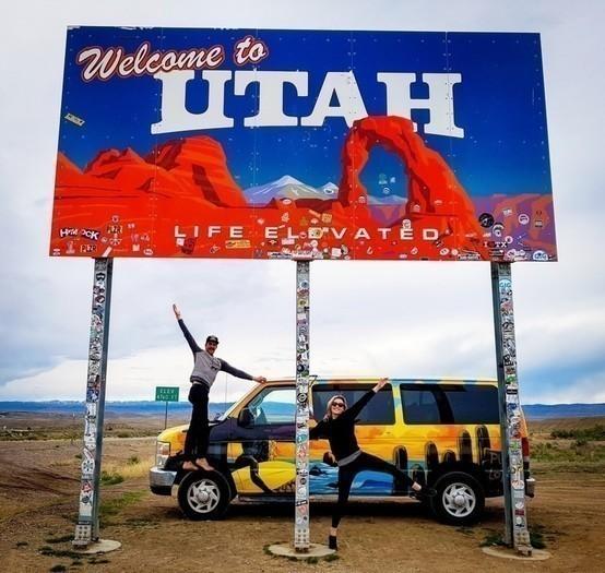 Utah-welcome-sign-campervan-couple